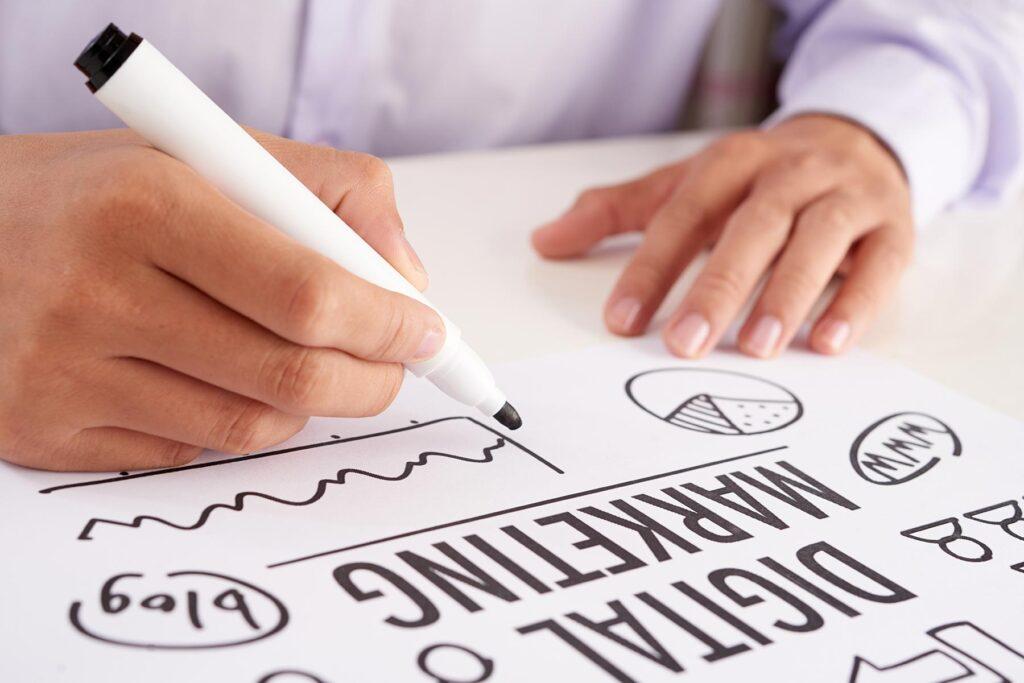 crop-hands-making-notes-on-digital-marketing-schem-89PCQZW.jpg